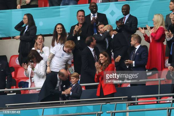 Prince William, President of the Football Association and Prince George along with Catherine, Duchess of Cambridge celebrate during the UEFA Euro...