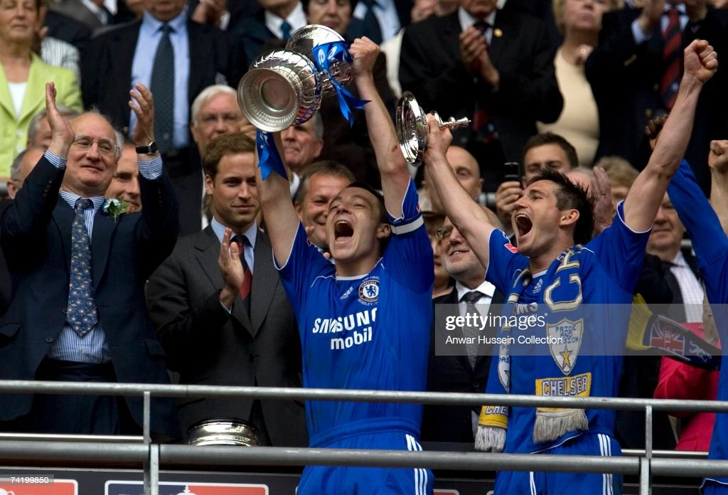 Prince William, President of the Football Association, watches John Terry and Frank Lampard (R) lift the cup at the FA Cup final between Chelsea FC and Manchester United FC at the new Wembley Stadium on May 19, 2007 in London, England.