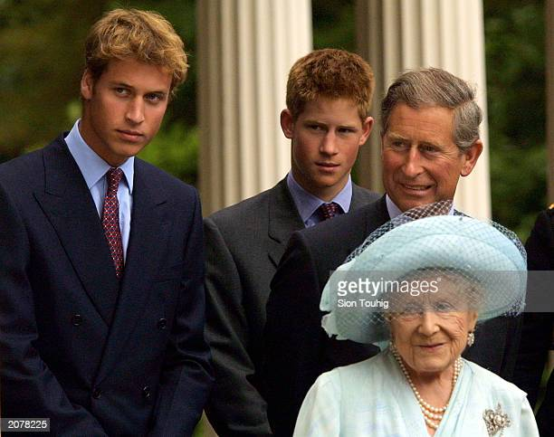 Prince William Prince Harry and Prince Charles appear with The Queen Mother during celebrations to mark her 101st birthday August 4 2001 in London...