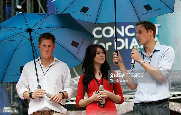 Prince William Prince Harry and soul singer Joss Stone on stage during rehearsals in the rain at Wembley Stadium before the 'Concert for Diana' June...