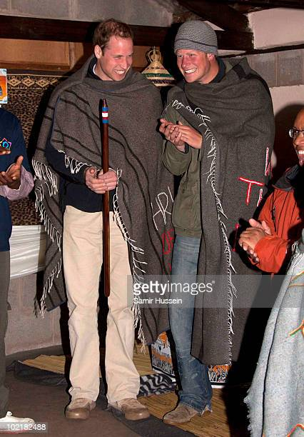 Prince William rand Prince Harry wear blankets to keep out the cold at the Herd Boy Night School on June 17 2010 in Semonkong Lesotho The Princes are...