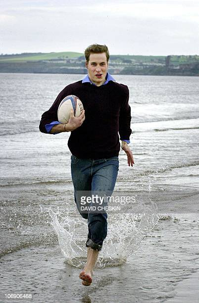 Prince William runs with a rugby ball on the beach at St Andrews 28 May 2003 The Prince is two years into a four year History of Art degree at the...