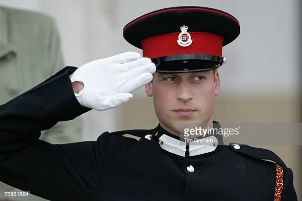 Prince William salutes during the Sovereign's Parade at Sandhurst Military Academy, passing-out as a commissioned officer on December 15, 2006 in...