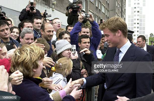 Prince William shakes hands with the crowd gathered outside the Sighthill Community Education Centre in Glasgow 21 September 2001 The troubled...