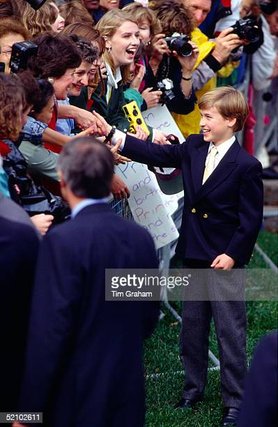 Prince William Shaking Hands With An Enthusiastic Crowd Of Women Who Have Come To Greet Him And His Family During Their Visit To Canada