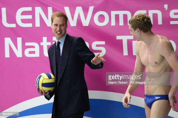 Prince William share a joke with Great Briain mens player Tom Curwen before throwing the ball to start Great Britain's match against Slovakia during...