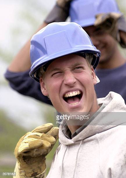 Prince William shares a joke while constructing walkways during his Raleigh International expedition December 7 2000 in the village of Tortel...