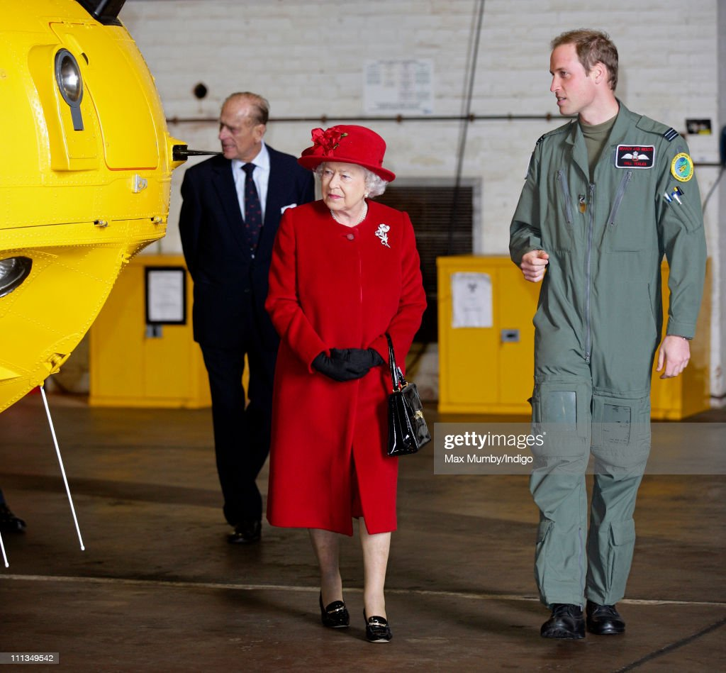 Prince William shows his grandmother Queen Elizabeth II around a Sea King search and rescue helicopter as she visits RAF Valley where Prince William works as a RAF search and rescue pilot on April 1, 2011 in Holyhead, United Kingdom.