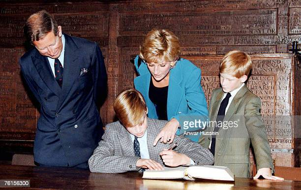 Prince William signs in on his first day at Eton College watched by his parents he Prince and Princess of Wales and brother Prince Harry on September...