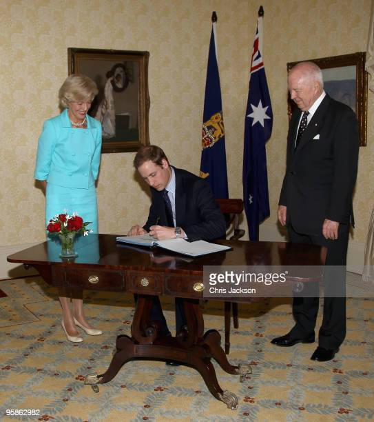 Prince William signs the visitors book as Australia's Governor General Her Excellency Ms Quentin Bryce and her husband His Excellency Mr Michael...