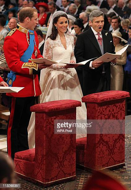 Prince William sings beside his bride Catherine Middleton and her father Michael Middleton on April 29 2011 in London England The marriage of Prince...