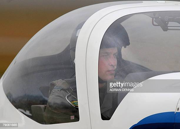 Prince William sits in the cockpit after landing a Grob 115E light aircraft known as the Tutor while training at airbase RAF Cranwell near Sleaford...