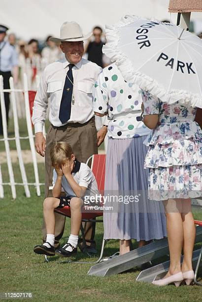 Prince William sitting with his head in his hands at the Cartier International Polo Day held at Smiths Lawn Polo Club in Windsor Berkshire England...