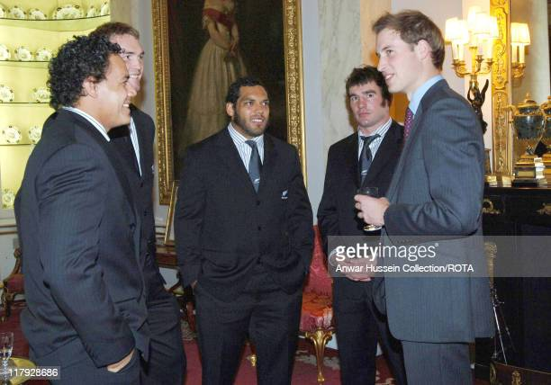 Prince William speaks with members of the All Blacks, New Zealand rugby team Chris Masoe, Jason Eaton, John Afoa and Andrew Hore, November 14 during...
