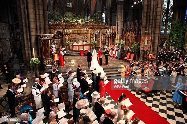 Prince William stands deside his bride Catherine Middleton with her father Michael Middleton on April 29 2011 in London England The marriage of...
