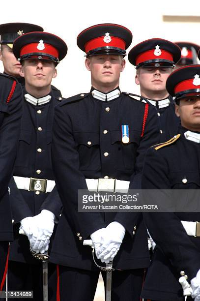 Prince William stands to attention at the passing-out Sovereign's Parade at Sandhurst Military Academy on April 12, 2006 in Sandhurst, England.