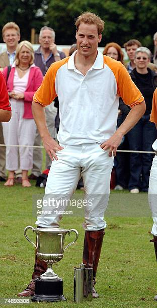 Prince William stands with his winning cup at a charity polo match for Apes Hill Club Barbados against Churchill Retirement Living for the Calcot...
