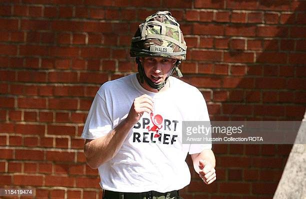 Prince William tackles an assault course, during his Sport Relief mile run at Sandhurst Military Academy on 8th July 2006. One-and-a-half-thousand...