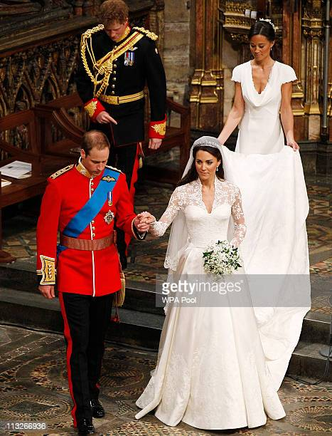 Prince William takes the hand of his bride Catherine Middleton now to be known as Catherine Duchess of Cambridge followed by Prince Harry and Pippa...