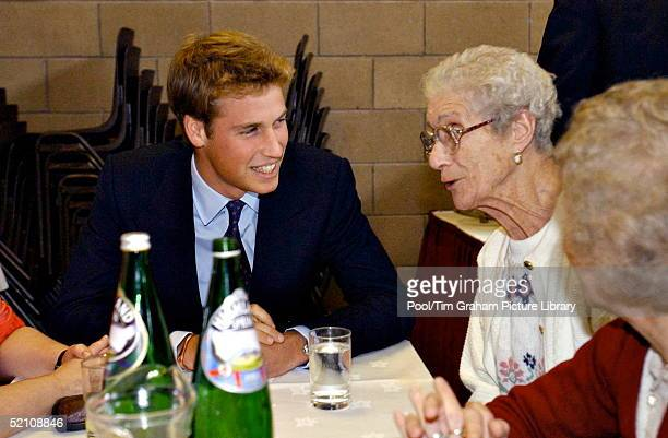 Prince William Talking With An Old Lady During His Visit To The Lunch Club For The Elderly At Sighthill Community Education Centre In Glasgow Scotland
