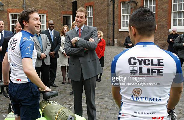 Prince William talks to members of the 'Cycle of Life' team at Clarence House before they set off for their 5000 mile bike ride across rural Africa...