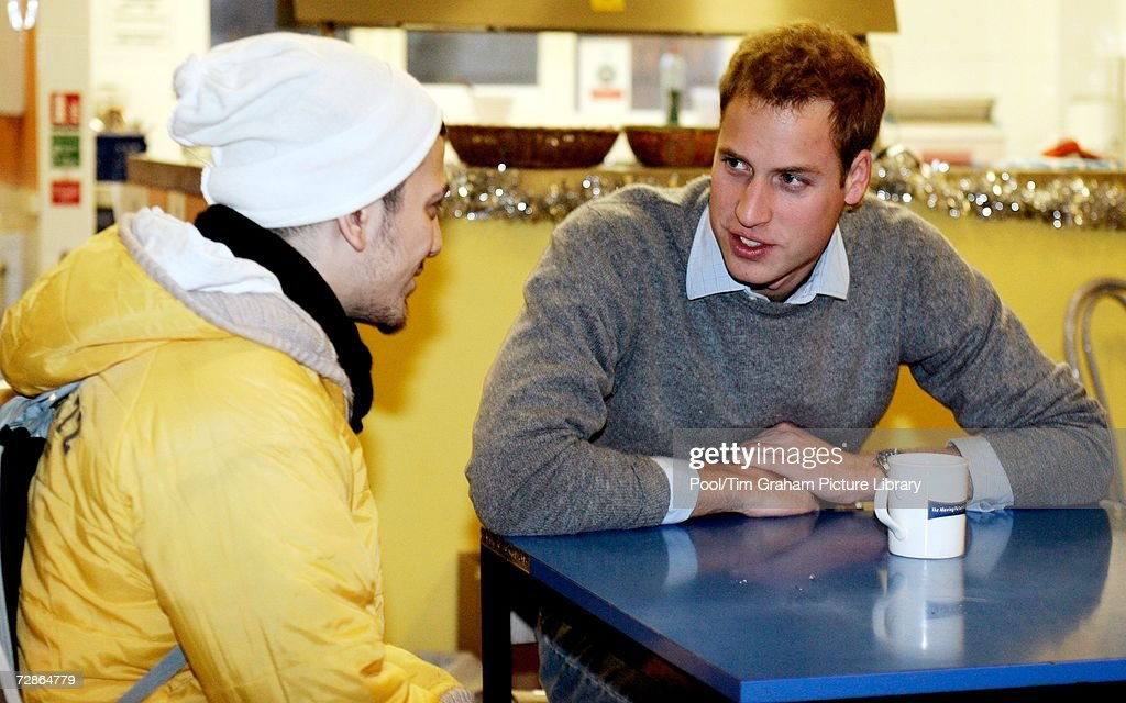 Prince William talks with a young homeless person at a Centrepoint homeless hostel during his visit to the centre on December 20, 2006 in London, England.