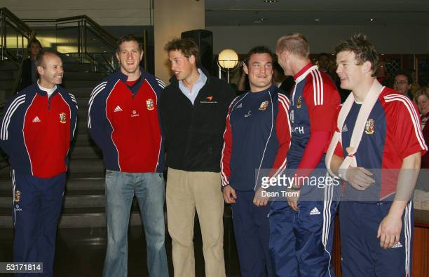 Prince William talks with British and Irish Lions coach Sir Clive Woodward and squad members Will Greenwood Gordon Bulloch Gareth Thomas and Brian...