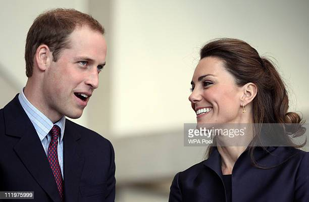 Prince William talks with fiancee Kate Middleton during a visit to Darwen Aldridge Community Academy on April 11 2011 in Darwen northwest England The...