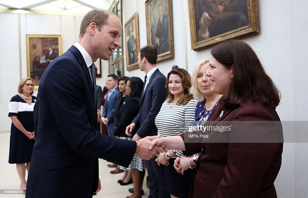 Prince WIlliam, The Duke of Cambridge meets staff after signing a book of condolence for Orlando mass shooting victims at the US Embassy on June 14, 2016 in London, England.