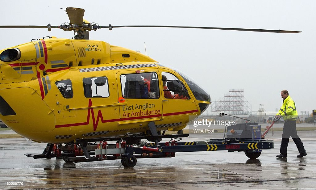 Prince William, The Duke of Cambridge prepares his helicopter as he begins his new job with the East Anglian Air Ambulance (EAAA) at Cambridge Airport on July 13, 2015 in Cambridge, England. The former RAF search and rescue helicopter pilot will work as a co-pilot transporting patients to hospital from emergencies ranging from road accidents to heart attacks.