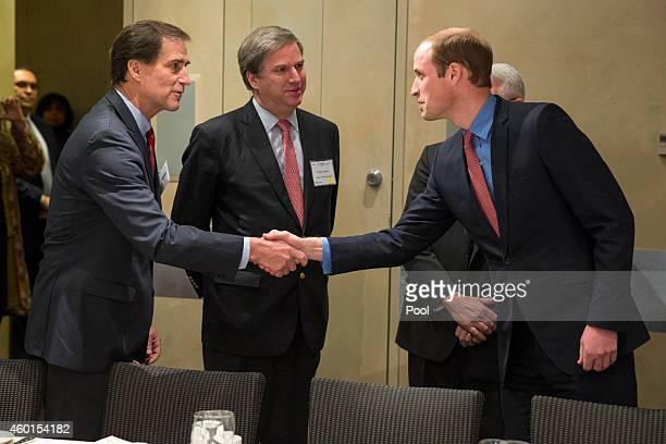 Prince William The Duke of Cambridge shakes hands with Dan Ashe Director of US Fish and Wildlife Service as Cristian Samper Wildlife Conservation...