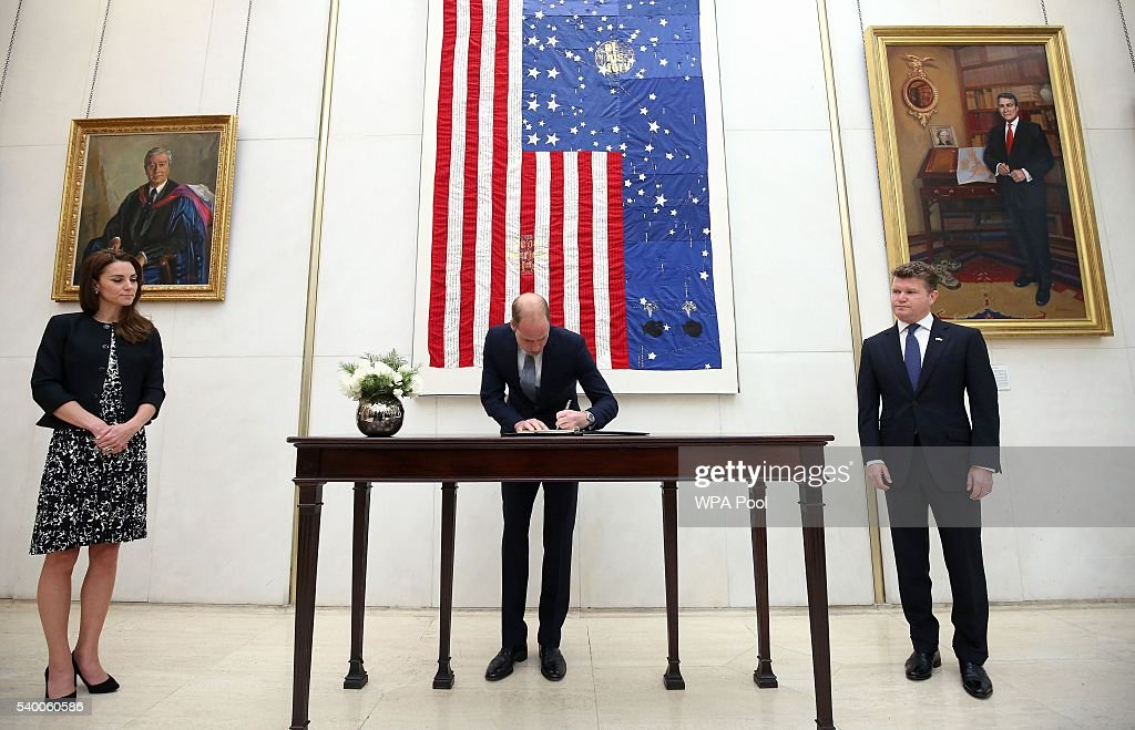 Prince WIlliam, The Duke of Cambridge signs a book of condolence for the Orlando mass shooting victims while Catherine, Duchess of Cambridge (L) and Matthew Barzun (R) , US Ambassador to London at the US Embassy on June 14, 2016 in London, England.