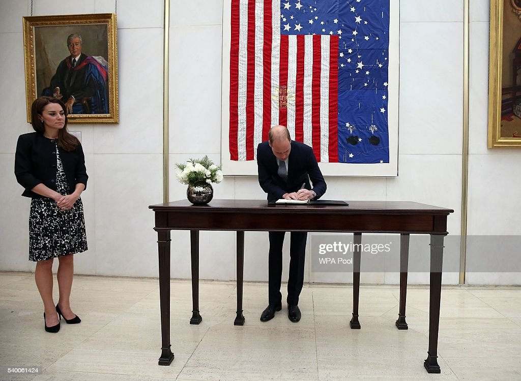 Prince WIlliam, The Duke of Cambridge signs a book of condolence for the Orlando mass shooting victims while Catherine, Duchess of Cambridge looks on at the US Embassy on June 14, 2016 in London, England.