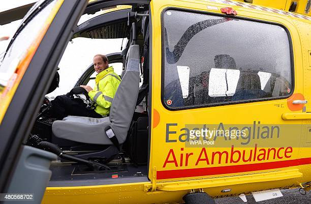 Prince William The Duke of Cambridge sits in the cockpit of an helicopter as he begins his new job with the East Anglian Air Ambulance at Cambridge...