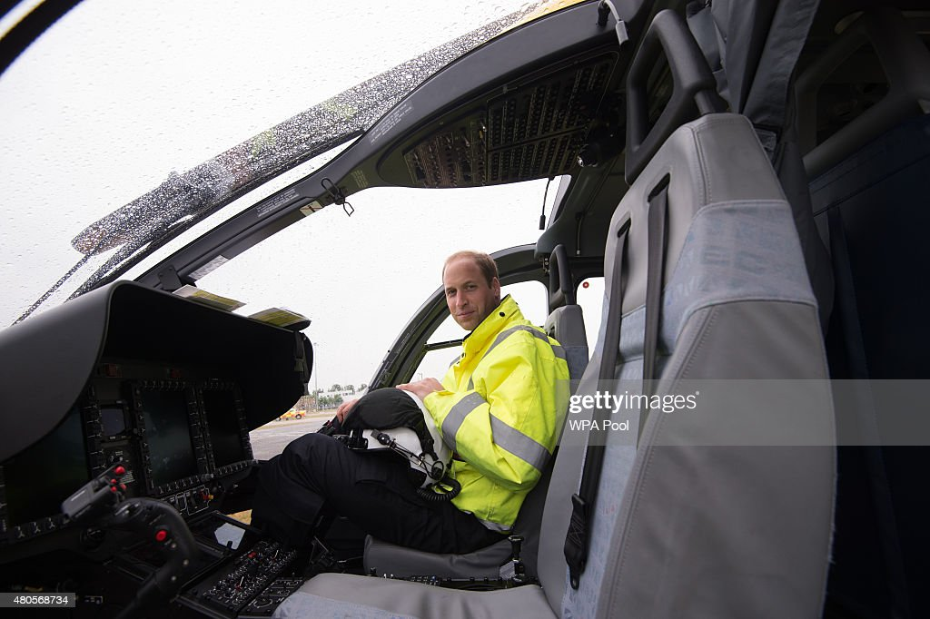 Prince William, The Duke of Cambridge sits in the cockpit of an helicopter as he begins his new job with the East Anglian Air Ambulance (EAAA) at Cambridge Airport on July 13, 2015 in Cambridge, England. The former RAF search and rescue helicopter pilot will work as a co-pilot transporting patients to hospital from emergencies ranging from road accidents to heart attacks.