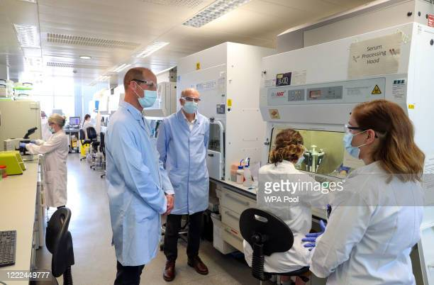 Prince William, The Duke of Cambridge wears a mask as he meets scientists, including Christina Dold , during a visit to the manufacturing laboratory...