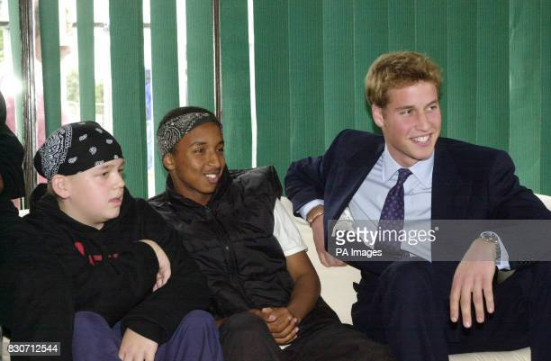 Prince William the older son of Prince Charles meets Garry McCulloch and Samy Omar during a visit to the Sighthill Community Centre in Glasgow The...