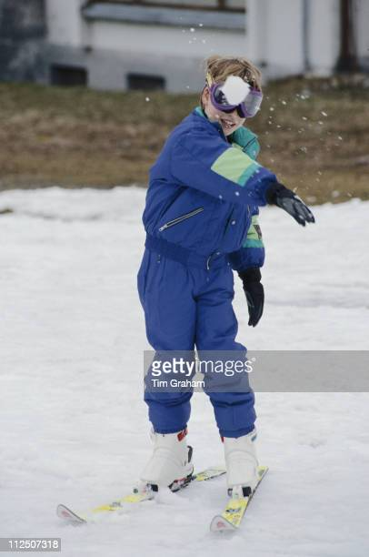 Prince William throwing a snowball towards the camera while dressed for skiing duing a skiing holiday in Lech Austria 10 April 1991