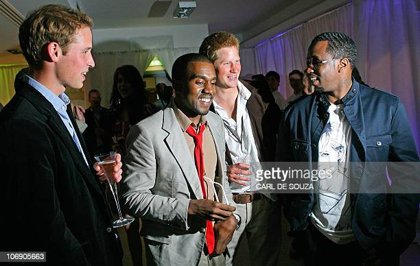 Prince William US rapper Kanye West Prince Harry and US rapper P Diddy talk during a backstage party at Wembley Arena in north London 01 July 2007 as...
