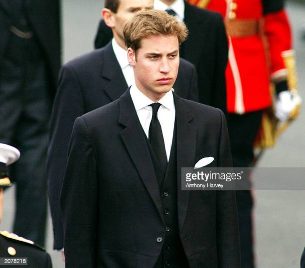 Prince William walks behind the Gun Carriage bearing the coffin of the Queen Mother as it makes its way to Westminster Abbey during her state funeral...