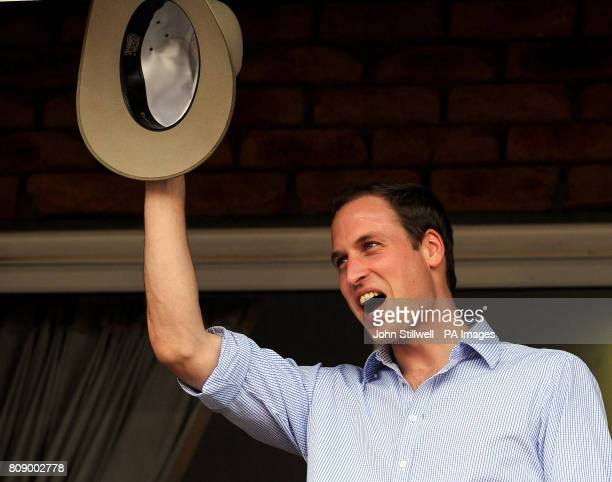 Prince William waves an Akubra hat that was given to him at the Toowoomba Showgrounds where a concert took place for the town near Brisbane Australia...