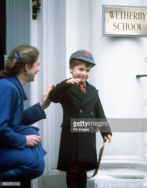 """Prince William waves at onlookers after his first day at his new school, """"Wetherby School"""" in Notting Hill Gate, London."""