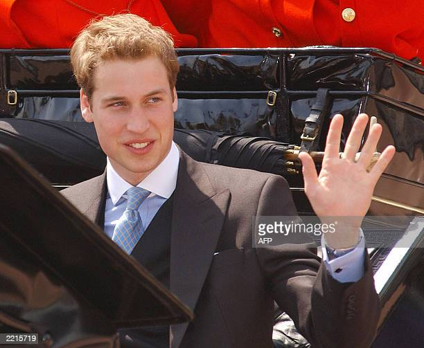 Prince William waves from his carriage on the way into Buckingham Palace 14 June 2003
