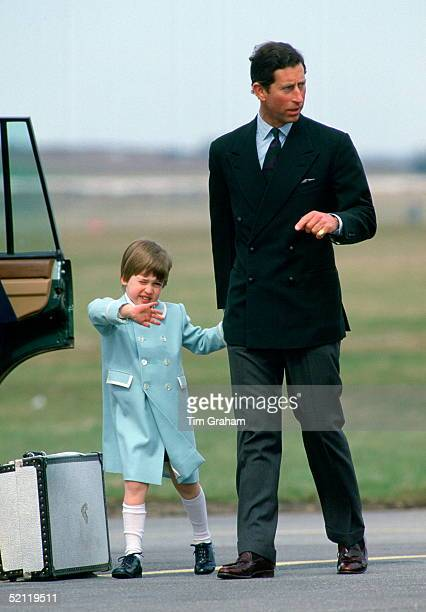 Prince William Waving To Onlookers As He And His Father Prince Charles Walk Hand In Hand To Their Car At Aberdeen Airport Prince William Is Wearing A...