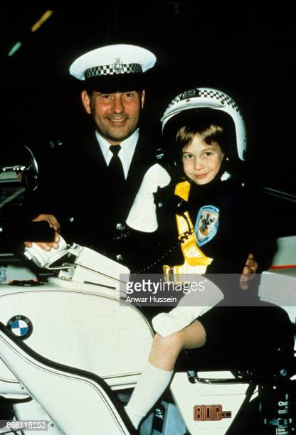 Prince William wearing a police helmet sits on a police motorbike during a visit to s police station on November 30 1987 in Windsor England