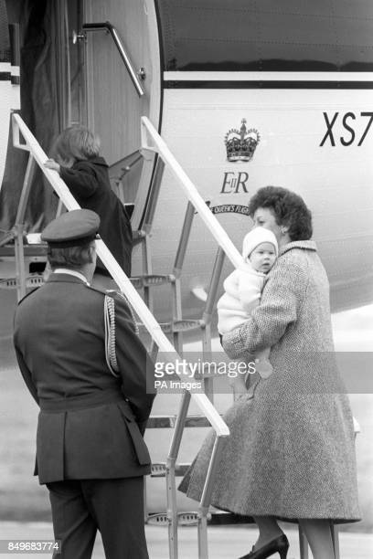 Prince William who will be three in June walks aboard the aircraft while his sixmonthold brother Prince Harry is carried aboard by nanny Barbara...