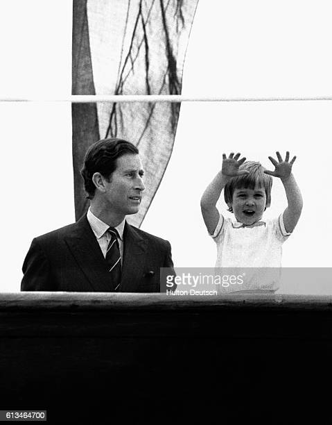 Prince William with his father Prince Charles aboard the Royal Yacht Britannia where they were reunited after the Prince and Princess of Wales' tour...