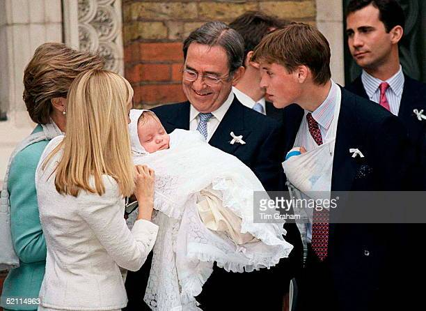 Prince William With His Godchild Konstantine Alexios Of Greece Held By King Constantine Of Greece At The Greek Cathedral Of Saint Sophia In London...