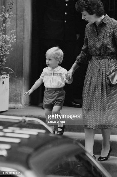 Prince William with his nanny Barbara Barnes leave St Mary's Hospital having visited his newborn brother Prince Harry in the Lindo wing with his...