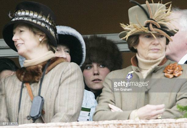Prince William's girlfriend, Kate Middleton discreetly stands at the back of the royal box to watch the Cheltenham Races on March 17, 2006 in...